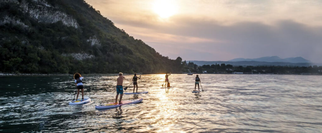 Group enjoying stand-up-paddle boards